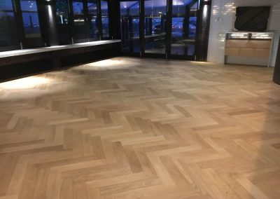 Re-sanding the floor of an Adelaide bar - After pics with the coat on
