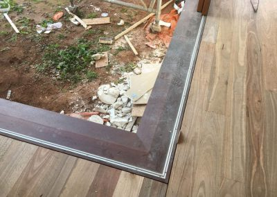 Installation in progress of a Spotted Gum floor in Unley