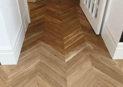 Coating being done on Chevron Parquetry Flooring in a Walkerville home