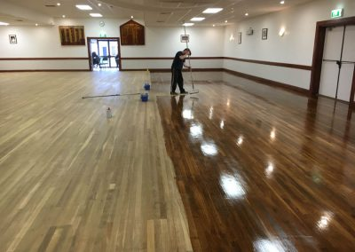 Hall floor re-sanding and polishing in progress in Findon