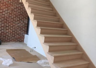 Sanding & applying Baltic pine and black stain to a staircase in a client's home in Norwood - Before