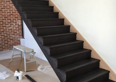 Sanding & applying Baltic pine and black stain to a staircase in a client's home in Norwood - After