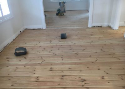 Sanding and applying Walnut stain to a client's floor in Glenelg