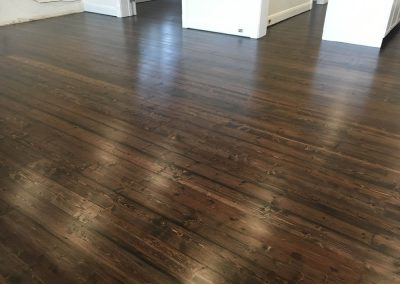 Sanding and applying Walnut stain to a client's floor in Glenelg - After