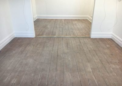 Sanding and polishing an old boutique pine floor in Thebarton - Before