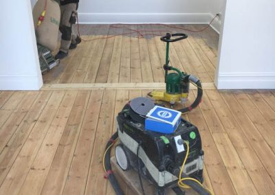 On-site, sanding and polishing an old boutique pine floor in Thebarton